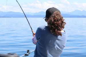 Woman salmon fishing outside Campbell River, B.C.