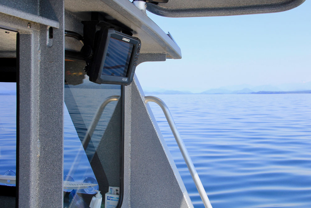 View of chartplotter and ocean from back of boat