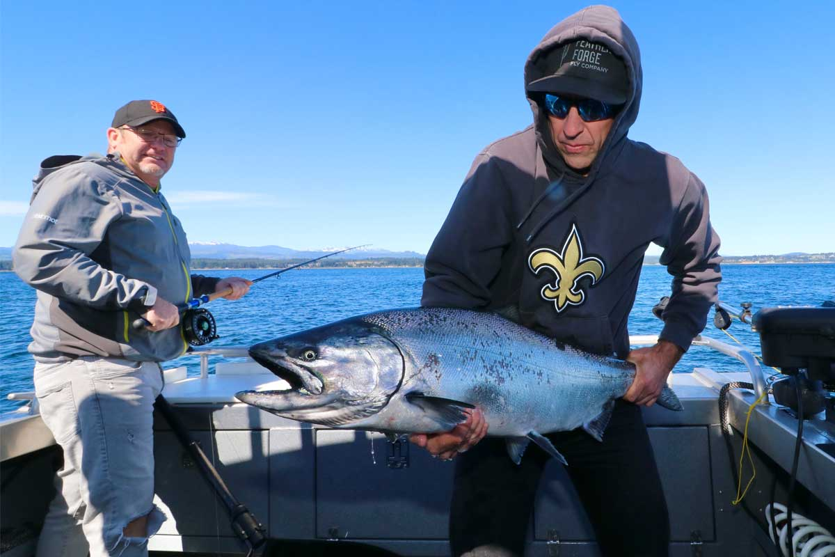 Men with Fishing Rod and Spring Salmon